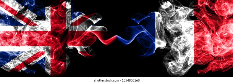 United Kingdom vs France, French smoky mystic flags placed side by side. Thick colored silky smoke flags of Great Britain and France, French.
