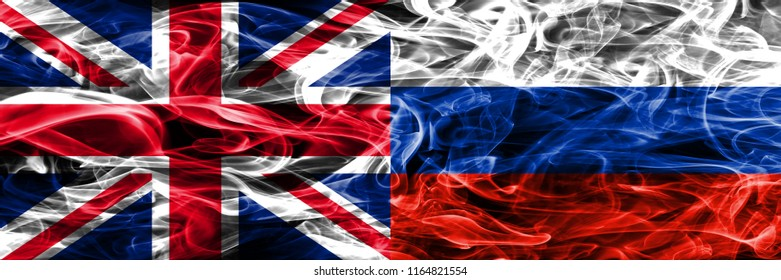 United Kingdom vs Russia smoke flags placed side by side. Thick colored silky smoke flags of Great Britain and Russia