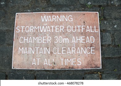 UNITED KINGDOM, YORK - AUGUST 8, 2016 A warning sign in the centre of York near the River Ouse informing about stormwater outfall chamber.