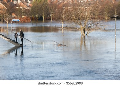 UNITED KINGDOM, YORK - DECEMBER 27, 2015  People looking at the Rowntree Park in York flooded by the River Ouse after days of heavy rain.