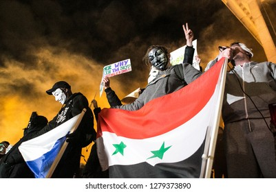UNITED KINGDON, LONDON, TRAFALGAR SQUARE, 11/05/2017. Member of annonymous holds up flag in support of Syria and the Government, as well as showing solidarity with Russian efforts.