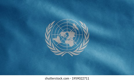 United Nations flag waving in the wind. Close up of UN banner blowing, soft and smooth silk. Cloth fabric texture ensign background. Use it for national day and country occasions concept.