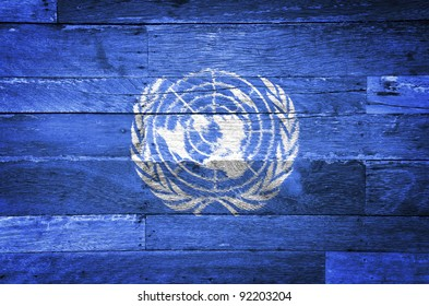 United Nations grunge flag painted on old wood background