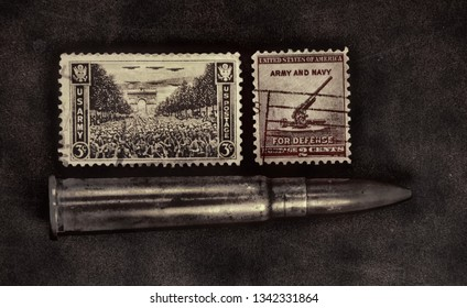 United States Of America - 1945 and 1940 : 3 cents and 2 cents stamps showing U.S. Army and Anti-Aircraft Gun.  1943 rifle ammunition below.