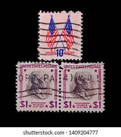 United States Of America - 1973 and 1938 : 10 cent and two 1 dollar stamps showing 50 and 13 star flags and Democratic President Woodrow Wilson.