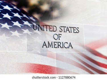 United States of America Building sign with an American flag behind it