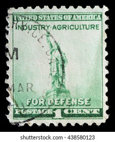 UNITED STATES OF AMERICA - CIRCA 1940: A used postage stamp printed in United States shows the Statue of Liberty on green background and the words Industry Agriculture for Defense program, circa 1940