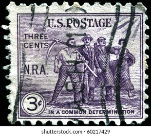 UNITED STATES OF AMERICA - CIRCA 1940s: A stamp printed in the United States devoted in common determination shows four men, circa 1940s