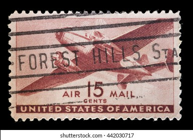 UNITED STATES OF AMERICA - CIRCA 1941: A used postage stamp printed in United States shows a twin-Motored Transport Plane in flight, circa 1941