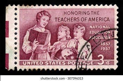 UNITED STATES OF AMERICA - CIRCA 1957: A stamp printed in the USA shows teacher with pupils, honoring the school teachers of America, circa 1957