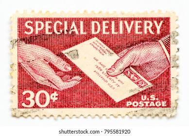 United States of America - CIRCA 1957 - Vintage 30cents US Postage stamp shows Special Delivery by hand and a letter