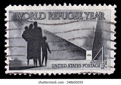 UNITED STATES OF AMERICA - CIRCA 1960: a stamp printed in USA shows refugee family walking toward new life, with inscription World Refugee Year, circa 1960