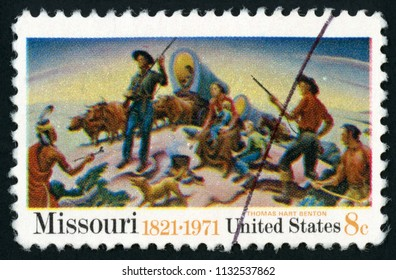 UNITED STATES OF AMERICA – CIRCA 1971: printed in USA (US) shows Pawnee facing hunter trapper and group of settlers; opening of West by Thomas Hart Benton; Missouri 1821-1971; Scott 1426; circa 1971