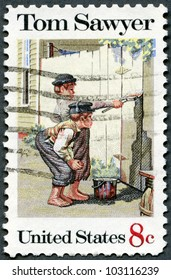 """UNITED STATES OF AMERICA - CIRCA 1972: A stamp printed in USA shows the painting """"Tom Sawyer"""" by Norman Rockwell (1894-1978), American Folklore Issue, circa 1972"""