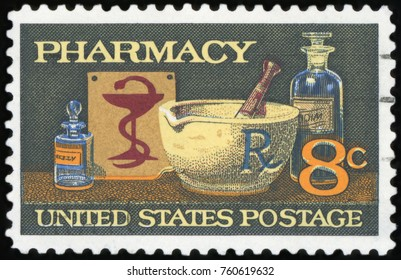 UNITED STATES OF AMERICA - CIRCA 1972: A stamp printed in America shows image of typical items in a pharmacy, mortar and pestle, bowl of Hygeia, circa 1972.