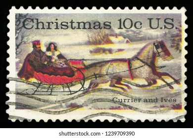 """UNITED STATES OF AMERICA - CIRCA 1974: A postage stamp printed in USA, Christmas Issue, shows """"The Road-Winter,"""" by Currier and Ives, circa 1974"""