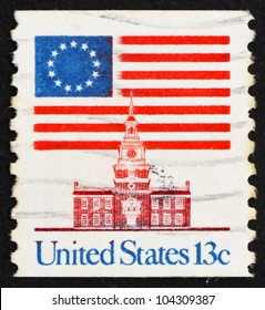 UNITED STATES OF AMERICA - CIRCA 1975: a stamp printed in the USA shows 13-Star Flag and Independence Hall, circa 1975