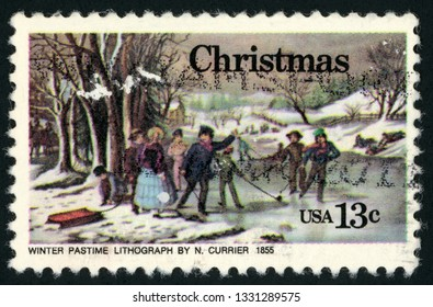 UNITED STATES OF AMERICA - CIRCA 1976: post stamp printed in US (USA) shows painting of winter pastime lithograph by Nathaniel Currier 1855; Christmas; Scott 1702 A1092 13c; circa 1976