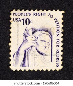 UNITED STATES OF AMERICA - CIRCA 1977: Postage stamp printed in USA with image of US Supreme Court Statue of Justice and the quote, people's right to petition for redress, for The Americana Series.