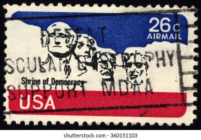 UNITED STATES OF AMERICA - CIRCA 1980: A stamp printed in USA shows National Memorial Stone Sculptures of George Washington, Thomas Jefferson, Theodore Roosevelt and Abraham Lincoln, circa 1980