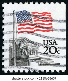UNITED STATES OF AMERICA - CIRCA 1981: post stamp printed in USA (US) shows flag over supreme court; Scott 1894 A1281 20c black blue red; circa 1981