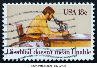 UNITED STATES OF AMERICA - CIRCA 1981: a stamp printed in the United States of America shows Disabled Man Looking through Microscope, circa 1981