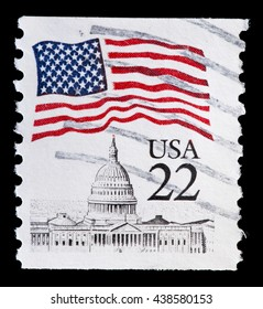 UNITED STATES OF AMERICA - CIRCA 1985: A used postage stamp printed in United States shows a waving USA flag above the Capitol city of Washington, circa 1985