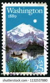 UNITED STATES OF AMERICA - CIRCA 1989: stamp printed in USA (US) shows Washington statehood centennial; boat on lake and mountain in background; Scott 2404 A1768 25c; circa 1989