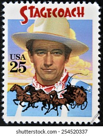 UNITED STATES OF AMERICA - CIRCA 1990: A stamp printed in USA shows  portrait of American actor John Wayne as The Ringo Kid in Stagecoach Western film, circa 1990.