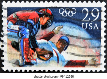 UNITED STATES OF AMERICA - CIRCA 1992: A stamp printed in USA shows Baseball, Runner sliding into home, circa 1992