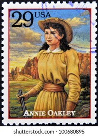 UNITED STATES OF AMERICA - CIRCA 1994: Stamp printed in USA shows Annie Oakley, American sharpshooter and exhibition shooter in old west , circa 1994