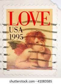 "UNITED STATES OF AMERICA - CIRCA 1995: A stamp printed in the United States of America shows image of an angel and the text ""love"", series, circa 1995"