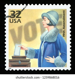 UNITED STATES OF AMERICA, CIRCA 1998: a postage stamp printed in USA showing an image of a woman voting about the 19th amendment to the US Constitution allowing women to vote, CIRCA 1998.