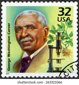 UNITED STATES OF AMERICA - CIRCA 1998: A stamp printed in USA shows George Washington Carver, series Celebrate the Century, 1910s, circa 1998