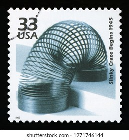 UNITED STATES OF AMERICA - CIRCA 1999: a postage stamp printed in USA showing an image of the slinky toy created by Richard James, CIRCA 1999.