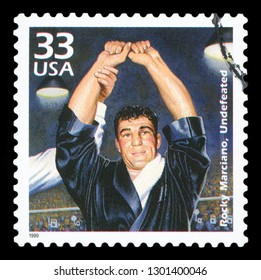 UNITED STATES OF AMERICA, CIRCA 1999: a postage stamp printed in USA showing an image of boxer Rocky Marciano, circa 1999.