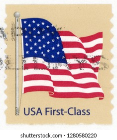 UNITED STATES OF AMERICA - CIRCA 2007: first class coil post stamp printed in US (USA) shows waving American flag on pole against tan background; Scott 4132; circa 2007