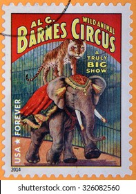 UNITED STATES OF AMERICA - CIRCA 2014: A stamp printed in USA shows tiger standing on elephant; wild animal Barnes circus; truly big show; circus vintage posters, circa 2014