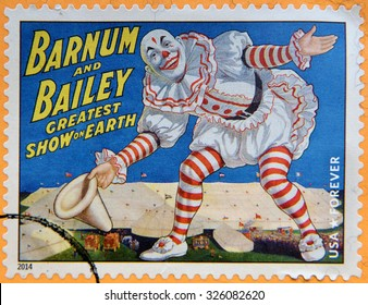 UNITED STATES OF AMERICA - CIRCA 2014: A stamp printed in USA shows smiling clown with white big hat in his hand and bowing, Barnum & Bailey greatest show on earth; circus vintage posters, circa 2014