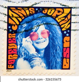 UNITED STATES OF AMERICA - CIRCA 2014: A stamp printed in USA shows music icon Janis Joplin; psychedelic soul; singer; Woodstock festival; Rock & Roll hall of fame, circa 2014