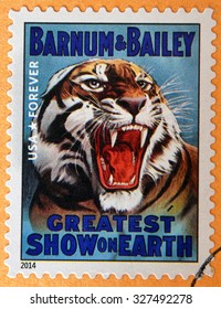 UNITED STATES OF AMERICA - CIRCA 2014: stamp printed in USA shows head of growling tiger; greatest show on earth; Barnum & Bailey; circus vintage posters, circa 2014
