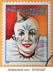 UNITED STATES OF AMERICA - CIRCA 2014: stamp printed in USA shows head of smiling clown with hat in his hand; Carl Hagenbeck-Wallace circus; circus vintage posters, circa 2014