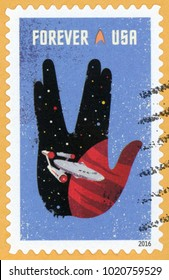 UNITED STATES OF AMERICA - CIRCA 2016: forever post stamp printed in USA (US) shows Starship Enterprise, planet and Vulcan Spock hand salute; Star Trek series; Scott 5135 blue, circa 2016