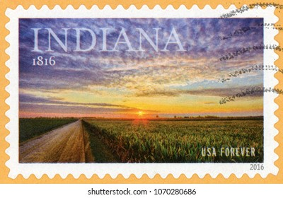 UNITED STATES OF AMERICA - CIRCA 2016: forever post stamp printed in US (USA) shows road in cornfield and sunset; Indiana statehood; Scott 5091; circa 2016