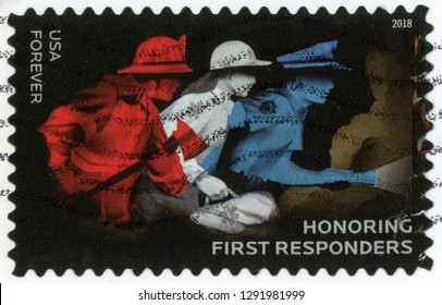 UNITED STATES OF AMERICA - CIRCA 2018: forever post stamp printed in US (USA) shows firefighter with axe, EMS worker with emergency bag, police officer with flashlight; honoring first responders; Scot