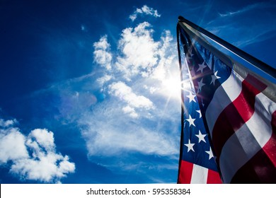 United States of America Flag with a blue sky background.