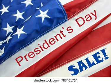 A United States of America flag draped as a border with a blue background and a message for President's Day sale in February