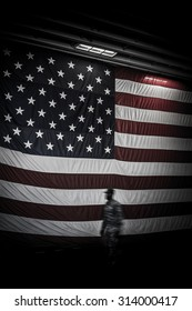The United States of America flag and the silhouette of a soldier.