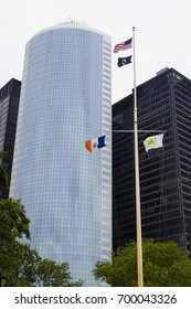 United States of America and New York City Flags with skyscrapers in the background