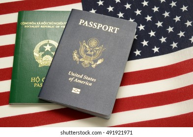 United states of america passport and vietnamese passport on us flag background